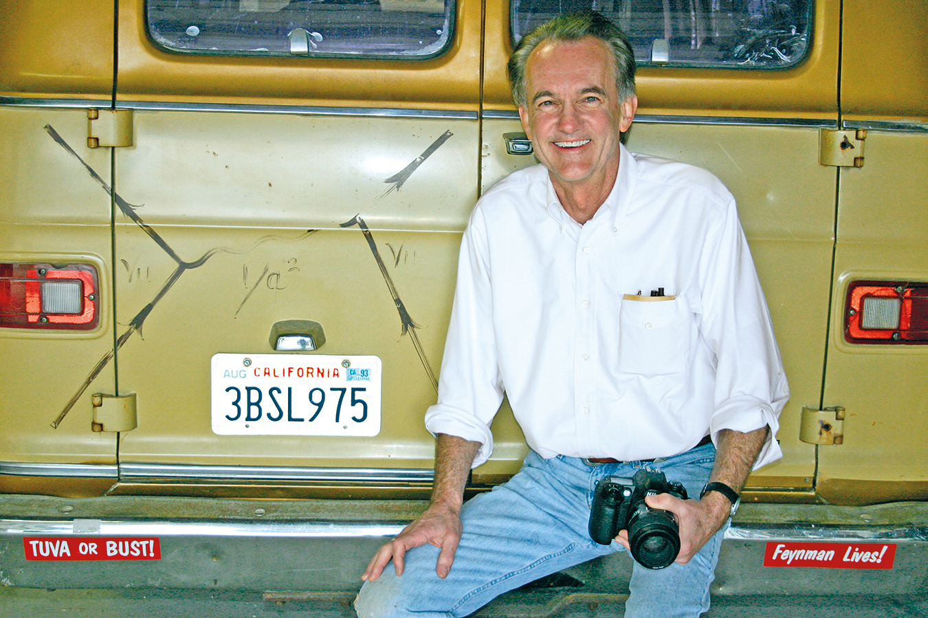 Edward Tufte with Richard Feynman's van, which sports one of the physicist's eponymous diagrams.