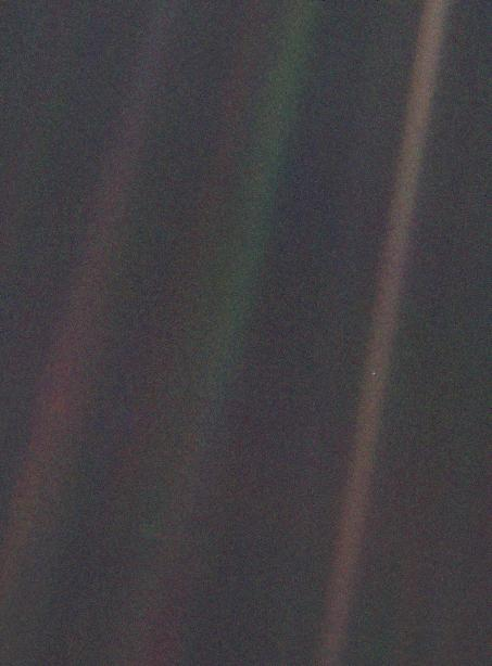 "This color image of Earth, taken by Voyager 1 in 1990 and dubbed ""Pale Blue Dot,"" is part of the first ever ""portrait"" of our solar system. Credit: NASA/JPL"