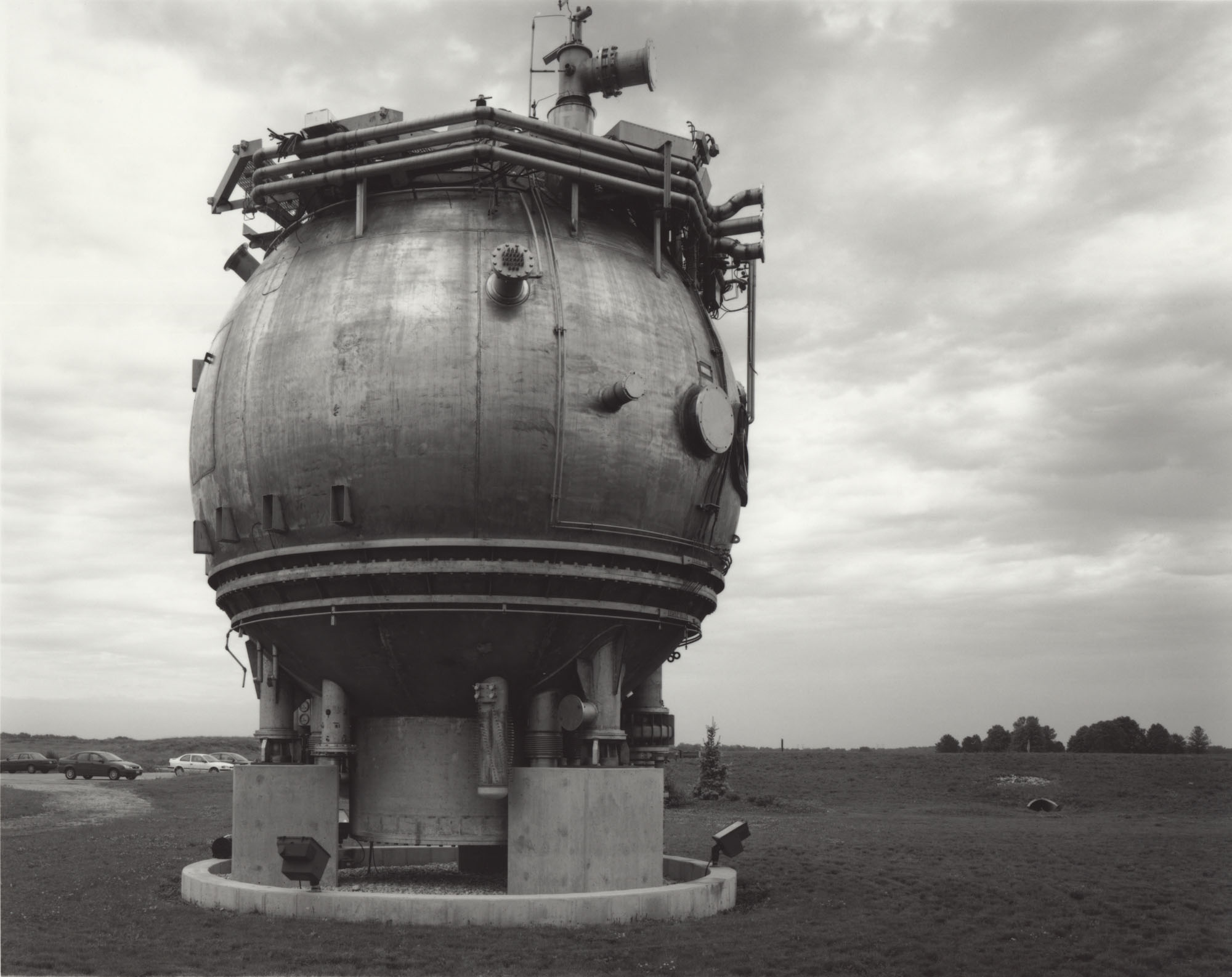The 15-foot bubble chamber at Fermi National Accelerator Laboratory in Batavia, Illinois (2006). No longer in operation, the chamber once allowed Fermilab physicists to study elusive high-energy particles such as kaons, lambdas, and electrons. When such particles were introduced into the chamber—which contained superheated hydrogen—they left bubble tracks that could be photographed and analyzed, according to Fermilab Today. Photo by Stanley Greenberg