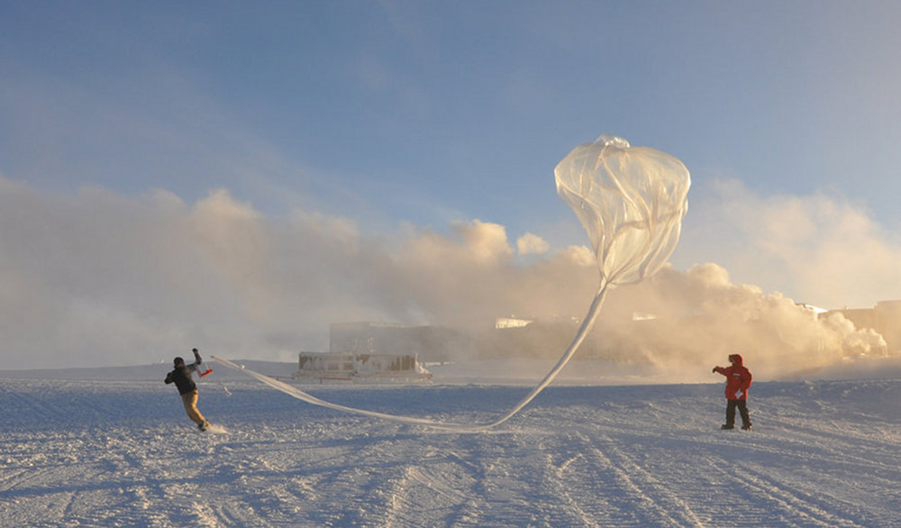 Researchers at the South Pole release a balloon-borne instrument to measure ozone levels from the ground up to 20 miles high. Image courtesy of Christine Schultz, NOAA