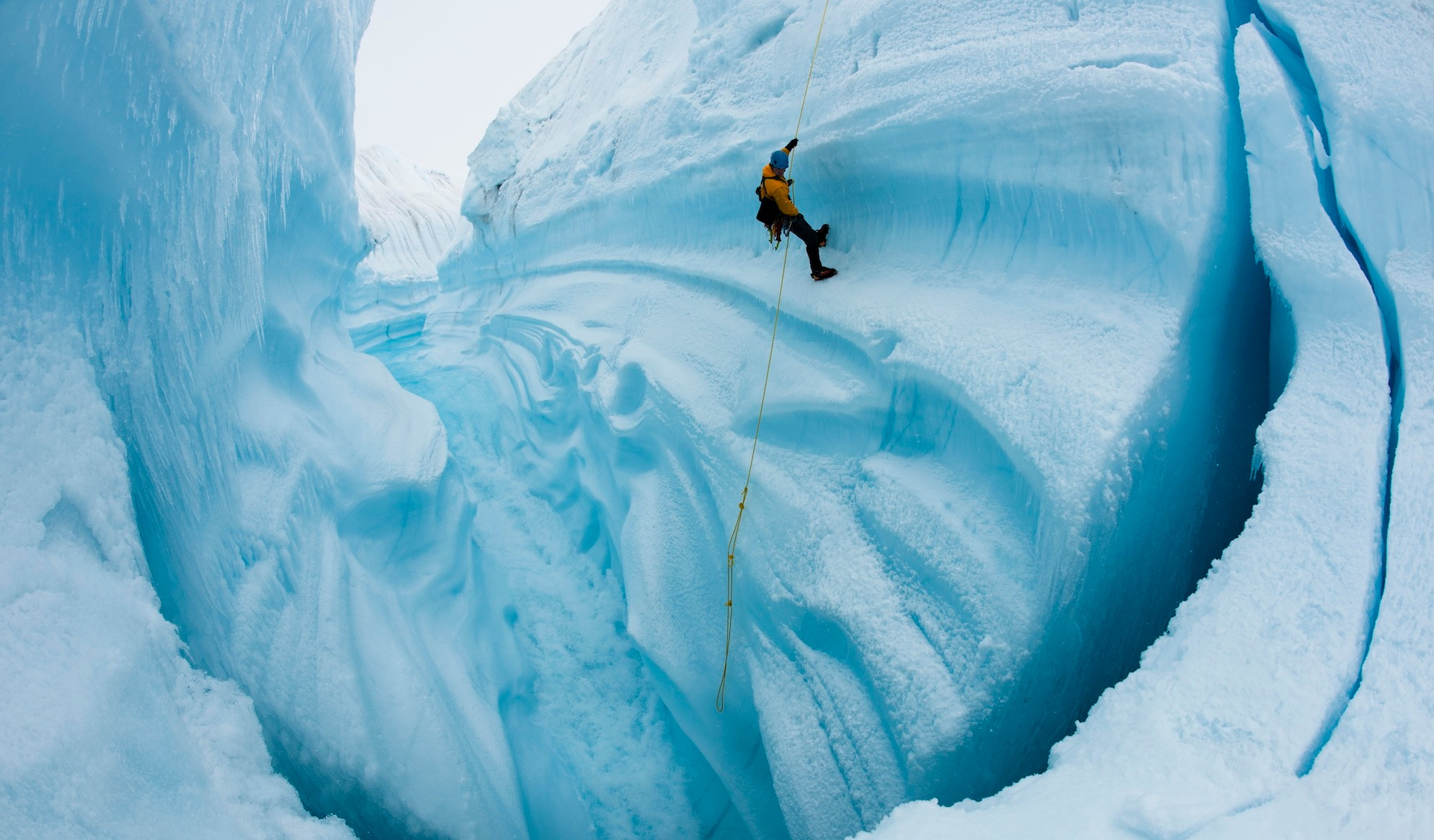 Adam LeWinter ice climbing in Survey Canyon, Greenland. Image courtesy of James Balog, Extreme Ice Survey