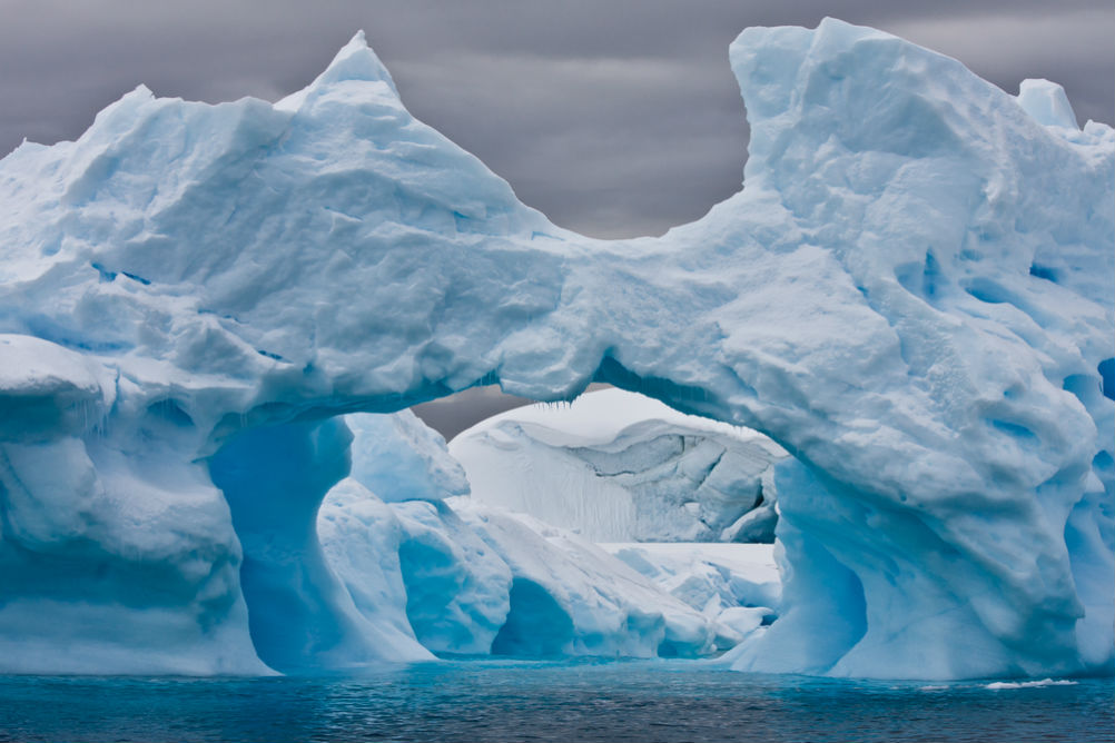 Large Arctic iceberg with a cavity inside. Image courtesy of Shuttershock