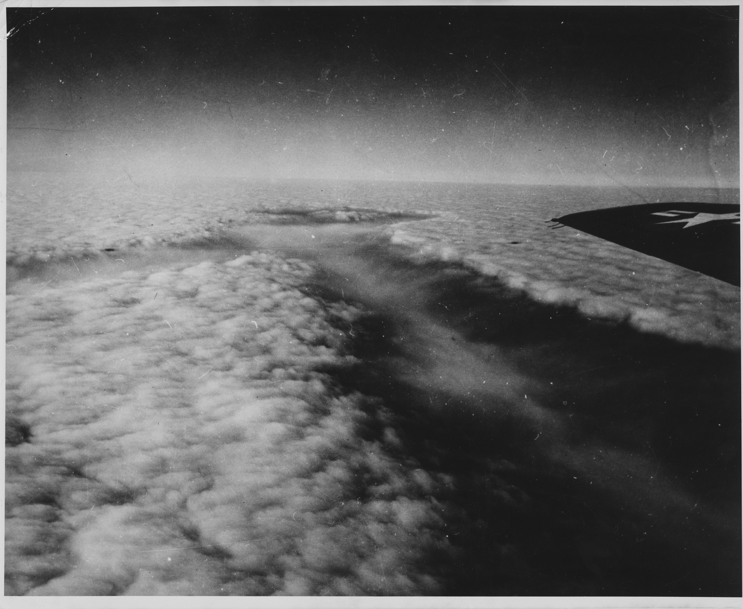 Kurt's brother Bernard Vonnegut advised the military's cloud-seeding initiative, Project Cirrus. Here, a Project Cirrus plane seeds a cloud with dry ice, creating a dramatic trench in the cloud. Photo by U.S. Army Signal Corps