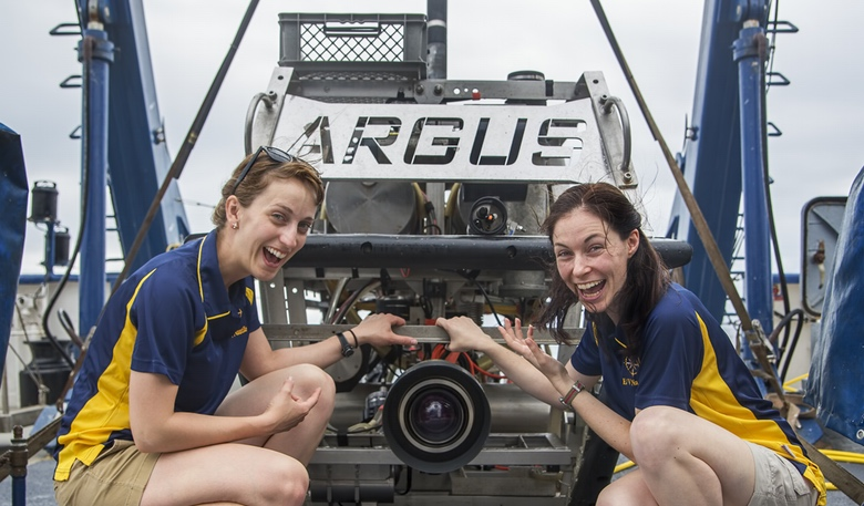 The authors Ariel Zych (left) and Rachel Rayner (right) with ROV Argus aboard the E/V Nautilus. 2015. Photo courtesy Ocean Exploration Trust