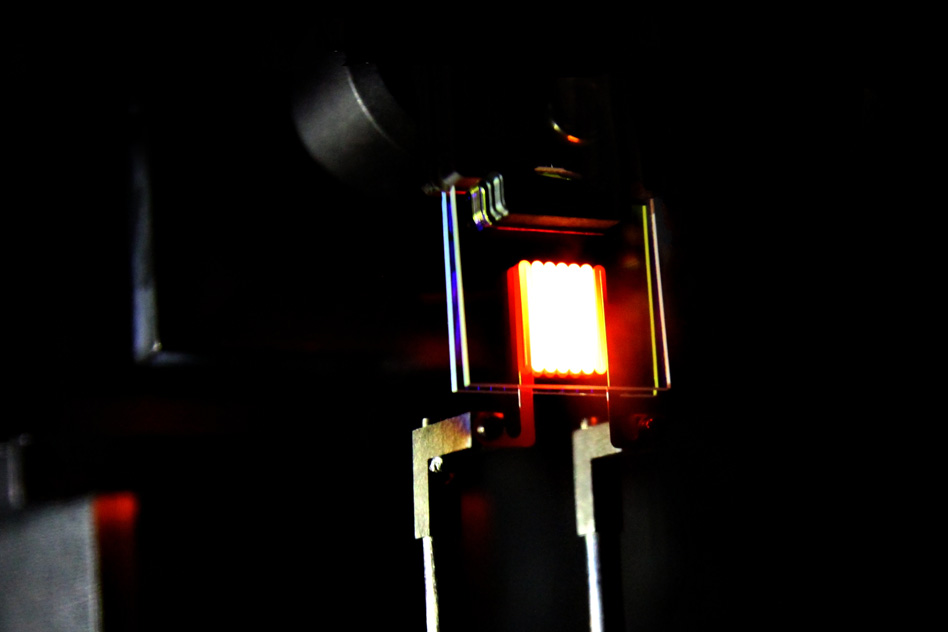 A proof-of-concept device built by MIT researchers demonstrates the principle of a two-stage process to make incandescent bulbs more efficient. This device already achieves efficiency comparable to some compact fluorescent and LED bulbs. Photo courtesy of MIT