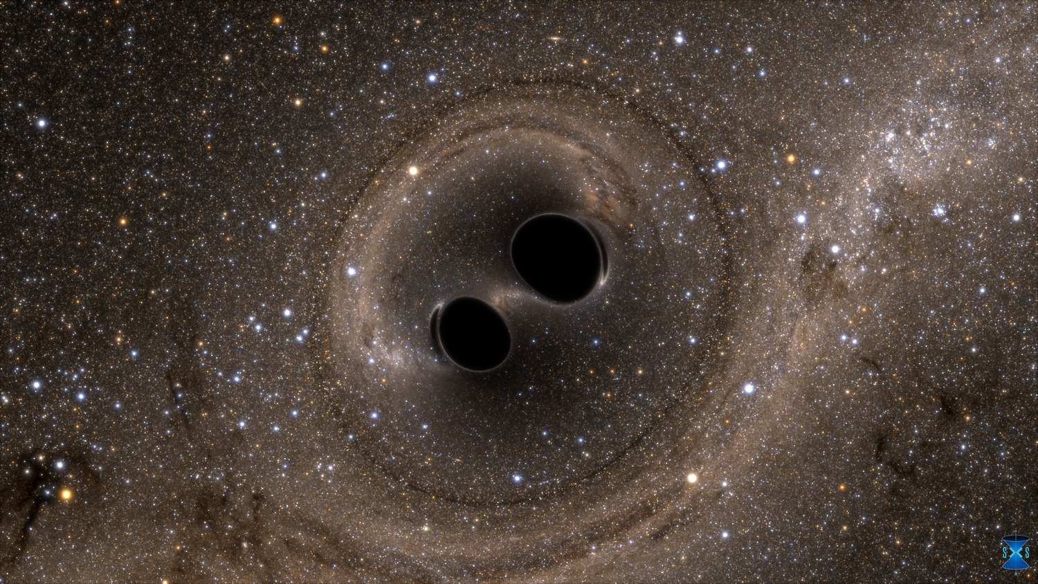 The collision of two black holes holes—a tremendously powerful event detected for the first time ever by the Laser Interferometer Gravitational-Wave Observatory, or LIGO—is seen in this still from a computer simulation. LIGO detected gravitational waves, or ripples in space and time generated as the black holes spiraled in toward each other, collided, and merged. This simulation shows how the merger would appear to our eyes if we could somehow travel in a spaceship for a closer look. It was created by solving equations from Albert Einstein's general theory of relativity using the LIGO data. Image by LIGO