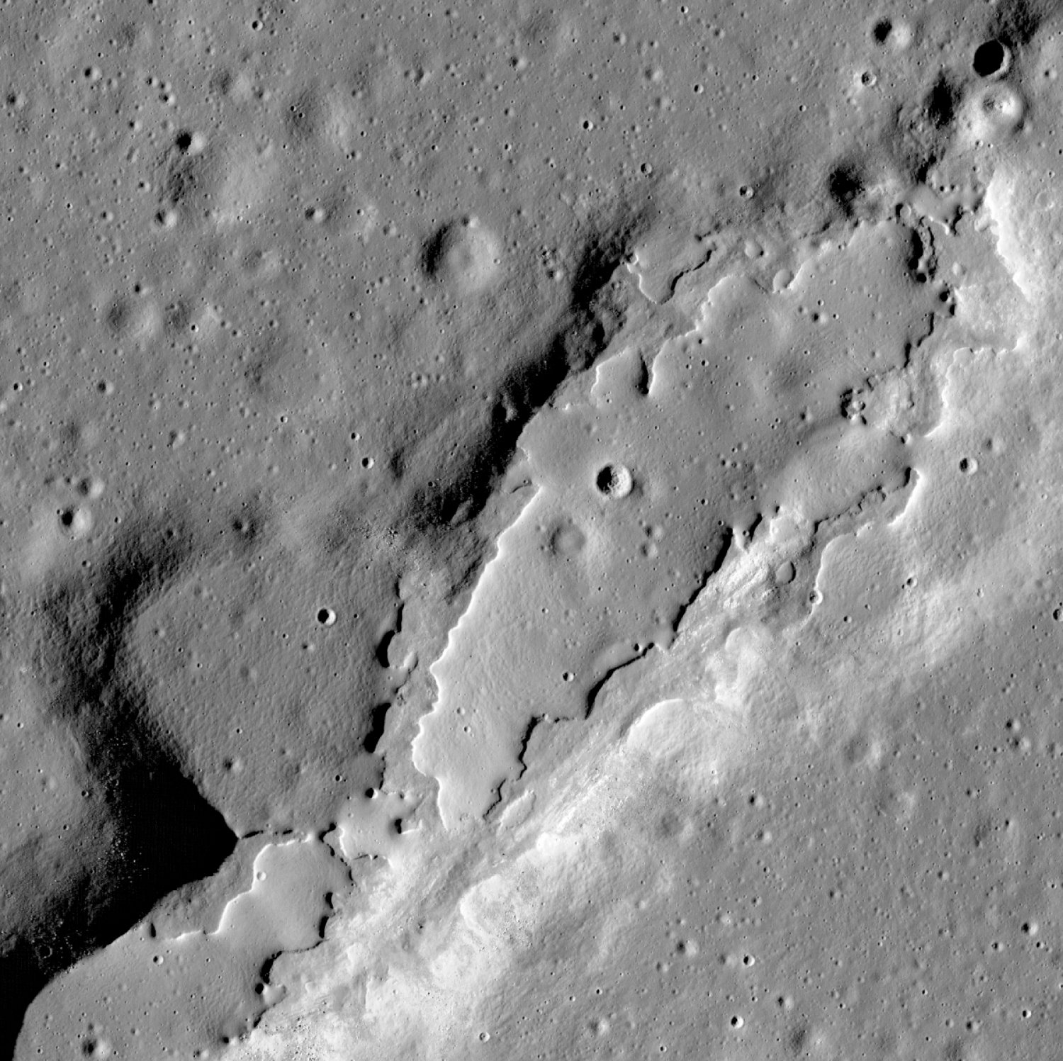 Lava flows have spread across the floor of this large collapsed area. Their lack of impact craters and steep sides show that they erupted relatively recently.  The LROC team reported in Nature in 2014 that some of these volcanic features could be younger than 100 million years old.  Their adolescence suggests that the moon's interior is perhaps hotter than once thought, and that future eruptions could occur on its surface. Credit: NASA/Goddard Space Flight Center/Arizona State University