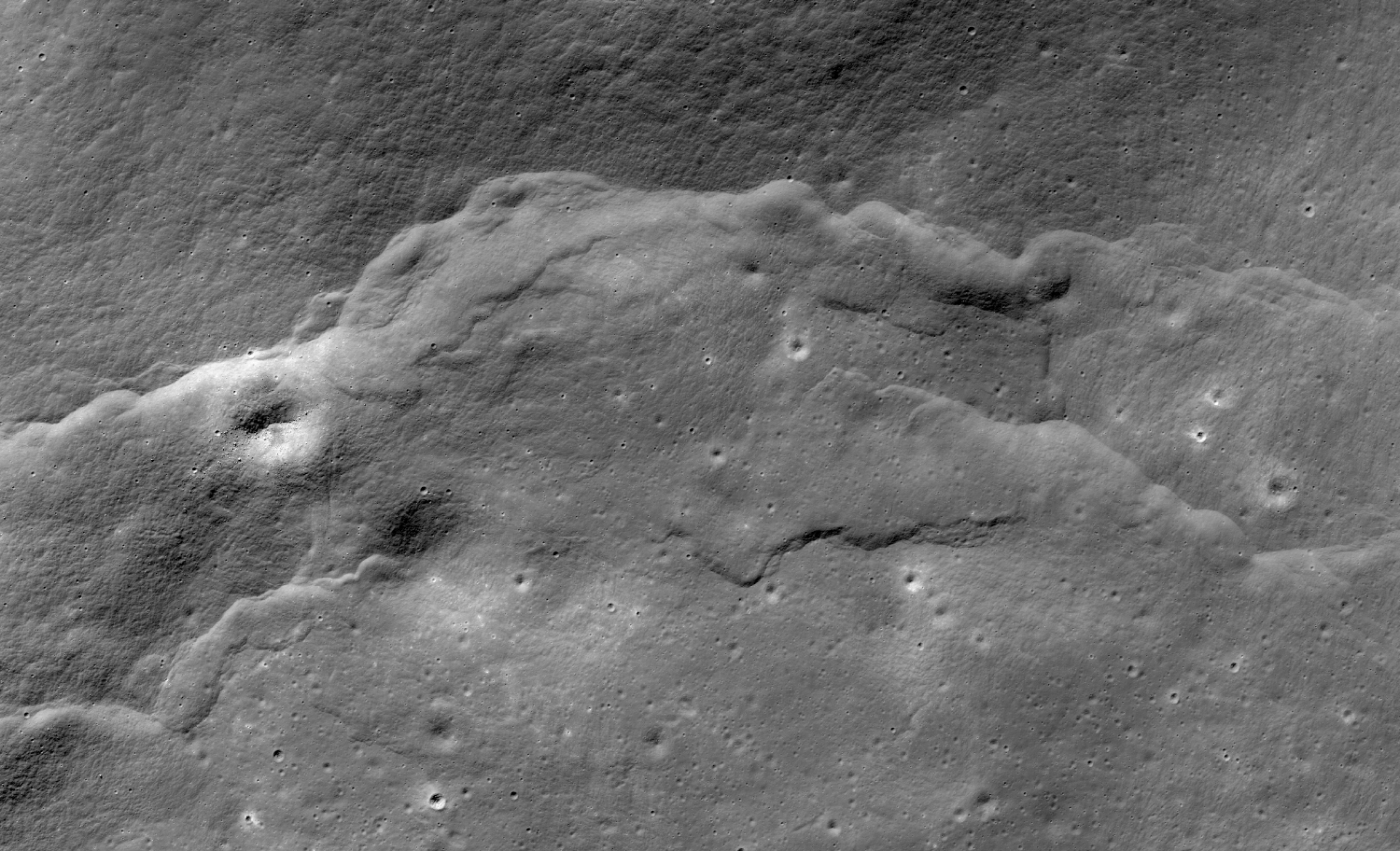 As this lobate scarp formed, it deformed a Copernican crater into a dimple-like feature. Lobate scarps provide evidence that the moon is shrinking. Credit: NASA/Goddard Space Flight Center/Arizona State University