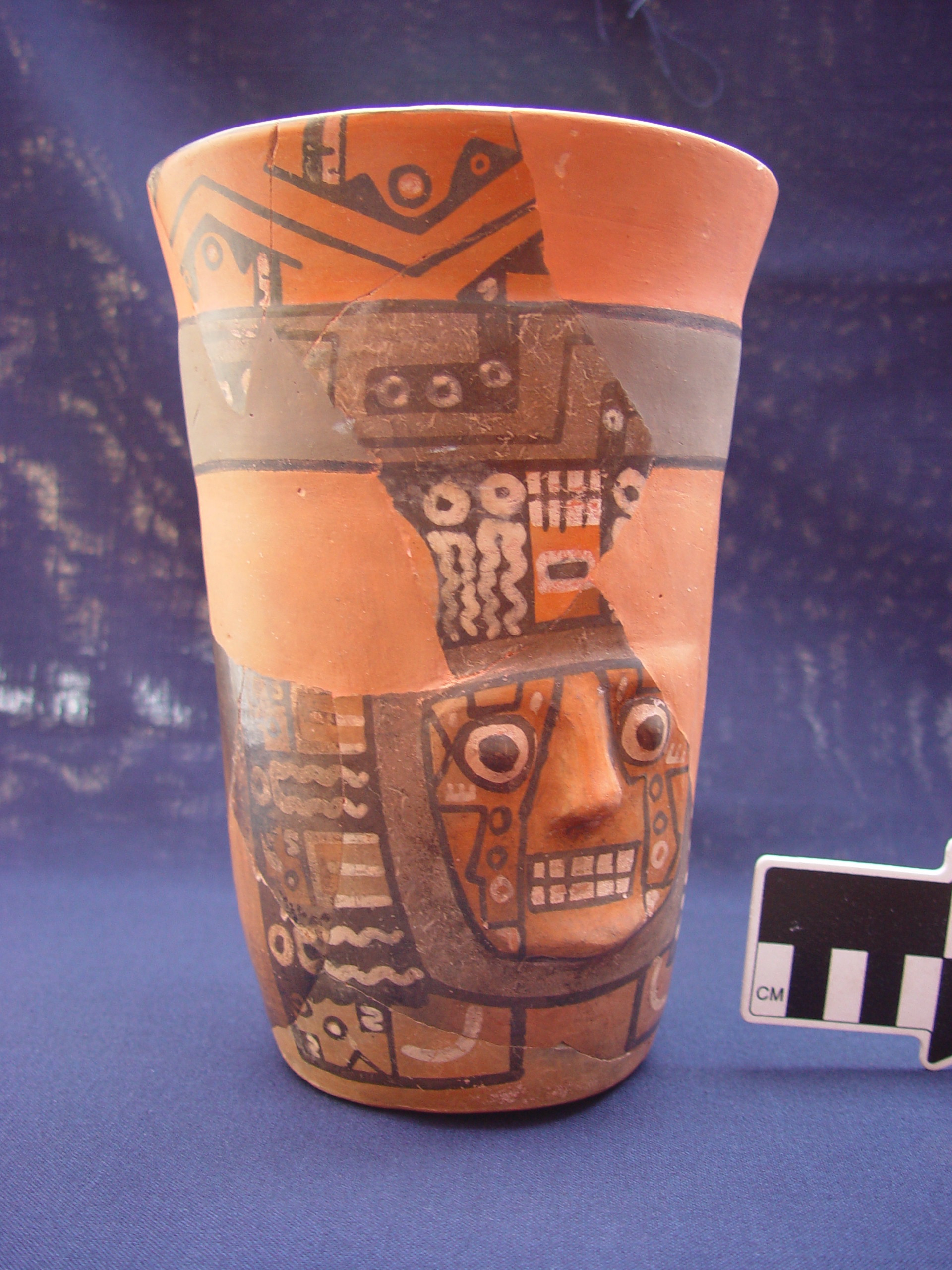 A Wari drinking vessel from Cerro Baul with a half-gallon capacity, depicting the face of a principal Wari deity, courtesy of the Cerro Baul Archaeological Project
