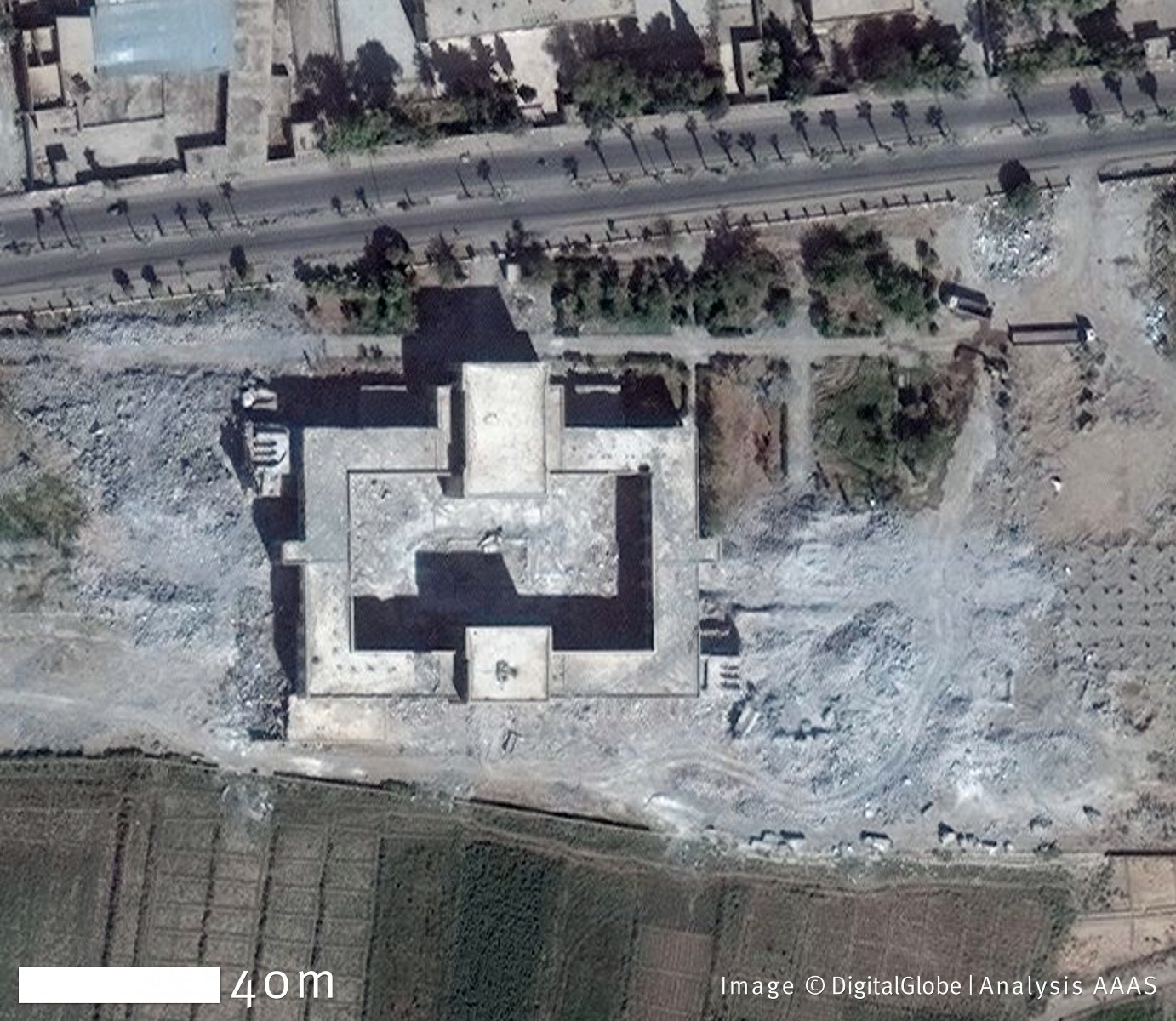 On April 8, 2011, the tombs of Uwais al-Qarani, Obay ibn Qays, and Ammar ibn Yasir, in the Syrian city of Raqqa, were undamaged. By October 6, 2014, however, all the tombs had been demolished, while leaving the roof of the central mosque intact. Damage to the building's interior decorative flooring is visible. Coordinates: 35.94 N, 39.02 E. Image ©DigitalGlobe | U.S. Department of State, NextView License | Analysis AAAS