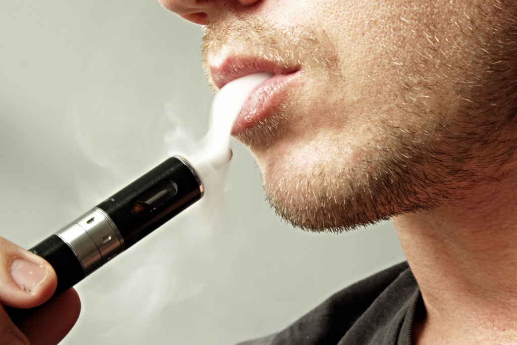 Smoking an e-cigarette. Credit: JohnWilliams/flickr/CC BY-NC 3.0 US