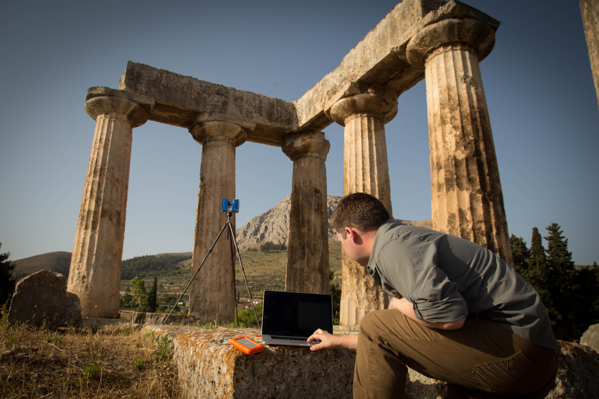 CyArk laser-scanning the Temple of Apollo at Ancient Corinth in Greece. Photo by CyArk