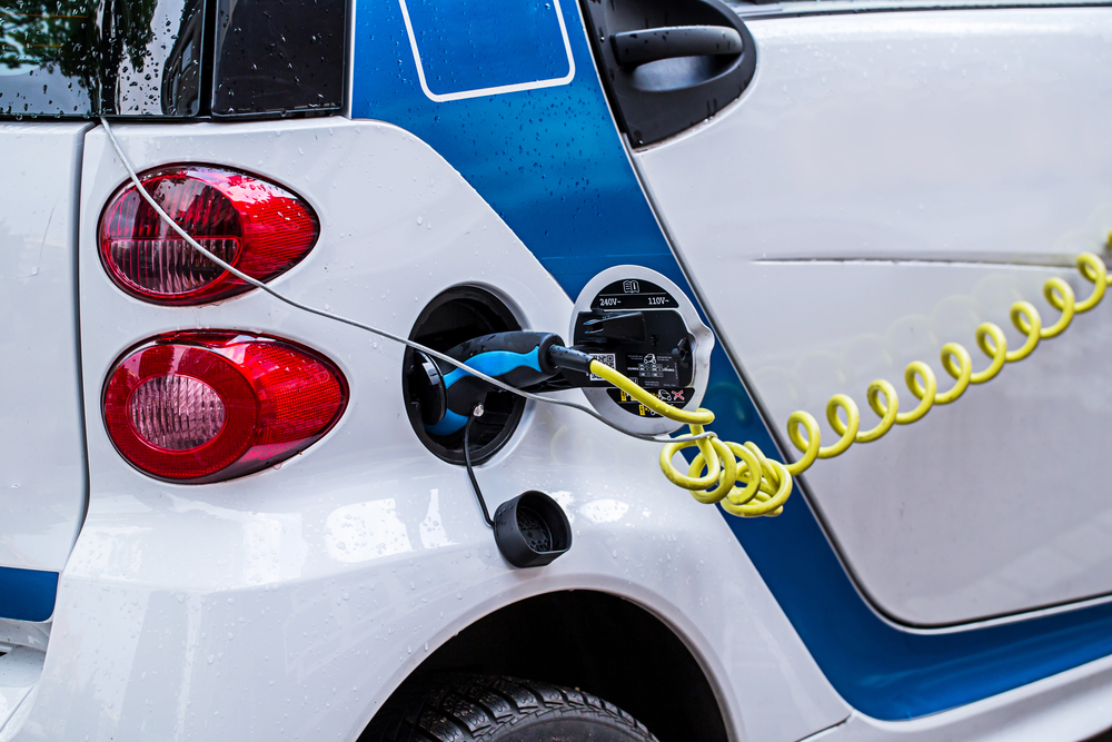 An electric car, charging, from Shutterstock
