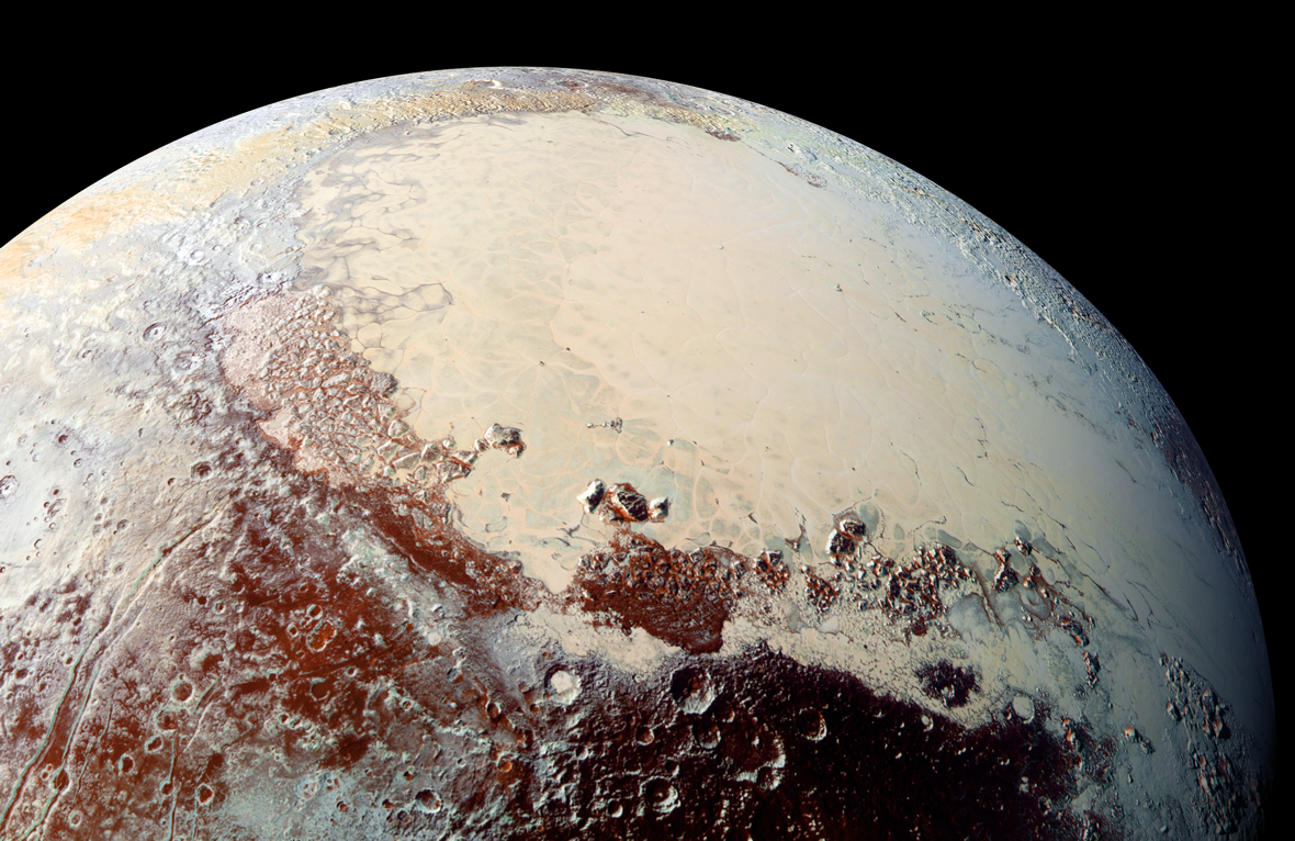 This image of Pluto captured by NASA's New Horizons spacecraft combines blue, red and infrared images. Credit:  Ralph/Multispectral Visual Imaging Camera (MVIC).
