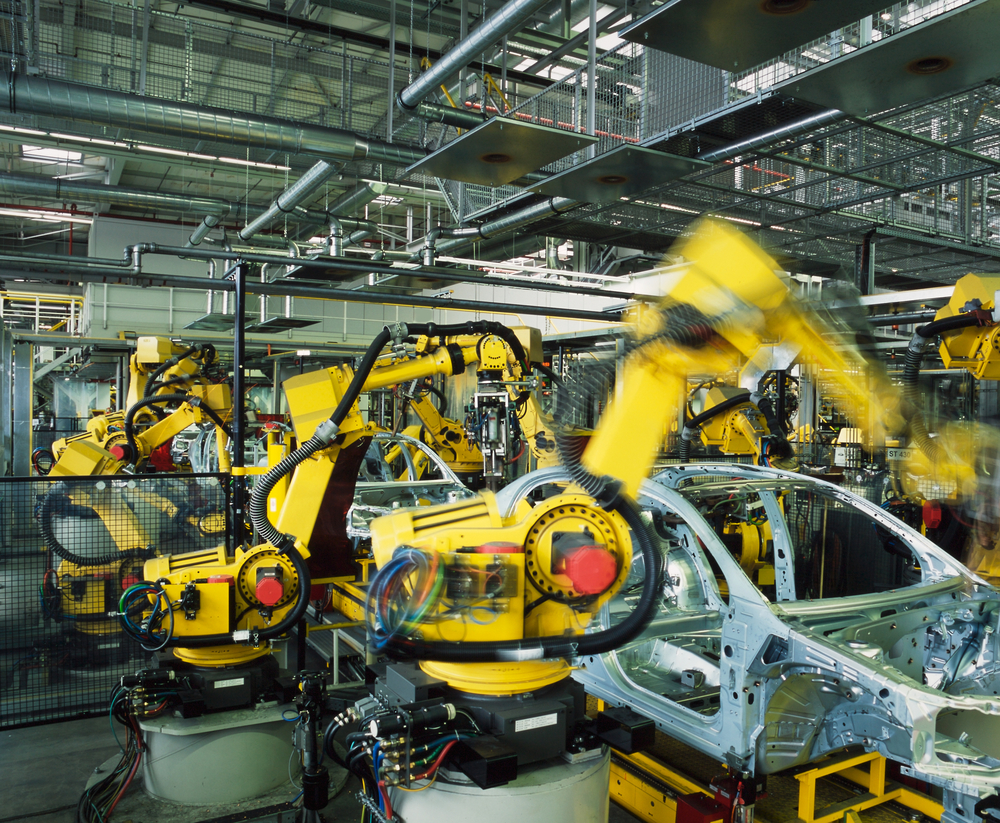 Robots building cars in a factory, from Shutterstock