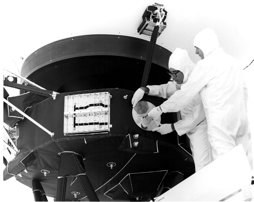 Engineers attaching the Golden Record to the Voyager spacecraft. Credit: NASA