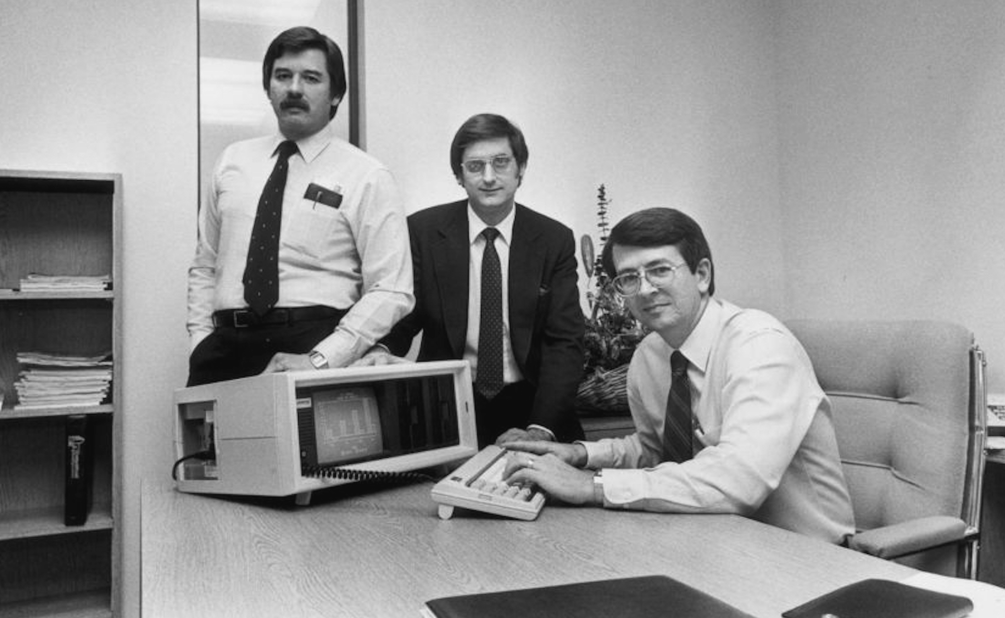 Compaq Computer Co-founders (L-R: Jim Harris, Bill Murto, Rod Canion) with the first Compaq portable computer. Courtesy of FilmRise.