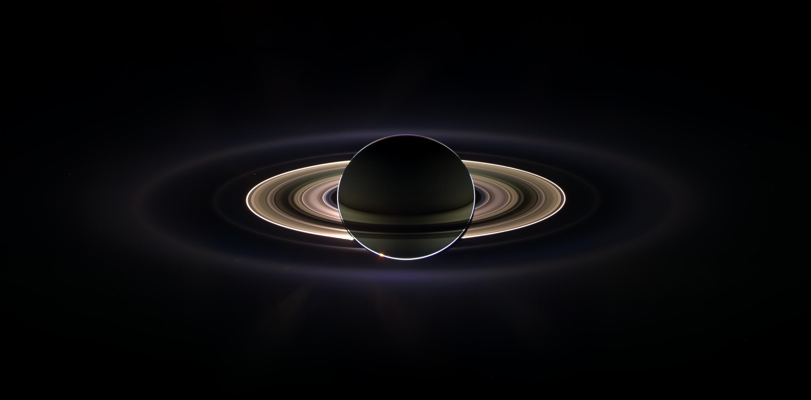 With giant Saturn hanging in the blackness and sheltering Cassini from the sun's blinding glare, the spacecraft viewed the rings as never before, revealing previously unknown faint rings and even glimpsing its home world. Credit: NASA/JPL/Space Science Institute