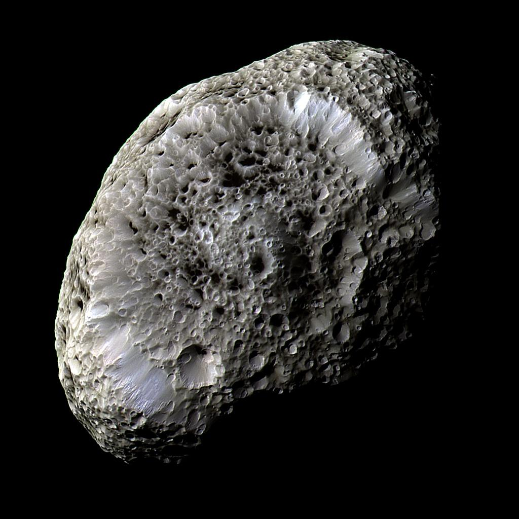 This stunning false-color view of Saturn's moon Hyperion reveals crisp details across the strange, tumbling moon's surface. Differences in color could represent differences in the composition of surface materials. Credit: NASA/JPL/Space Science Institute