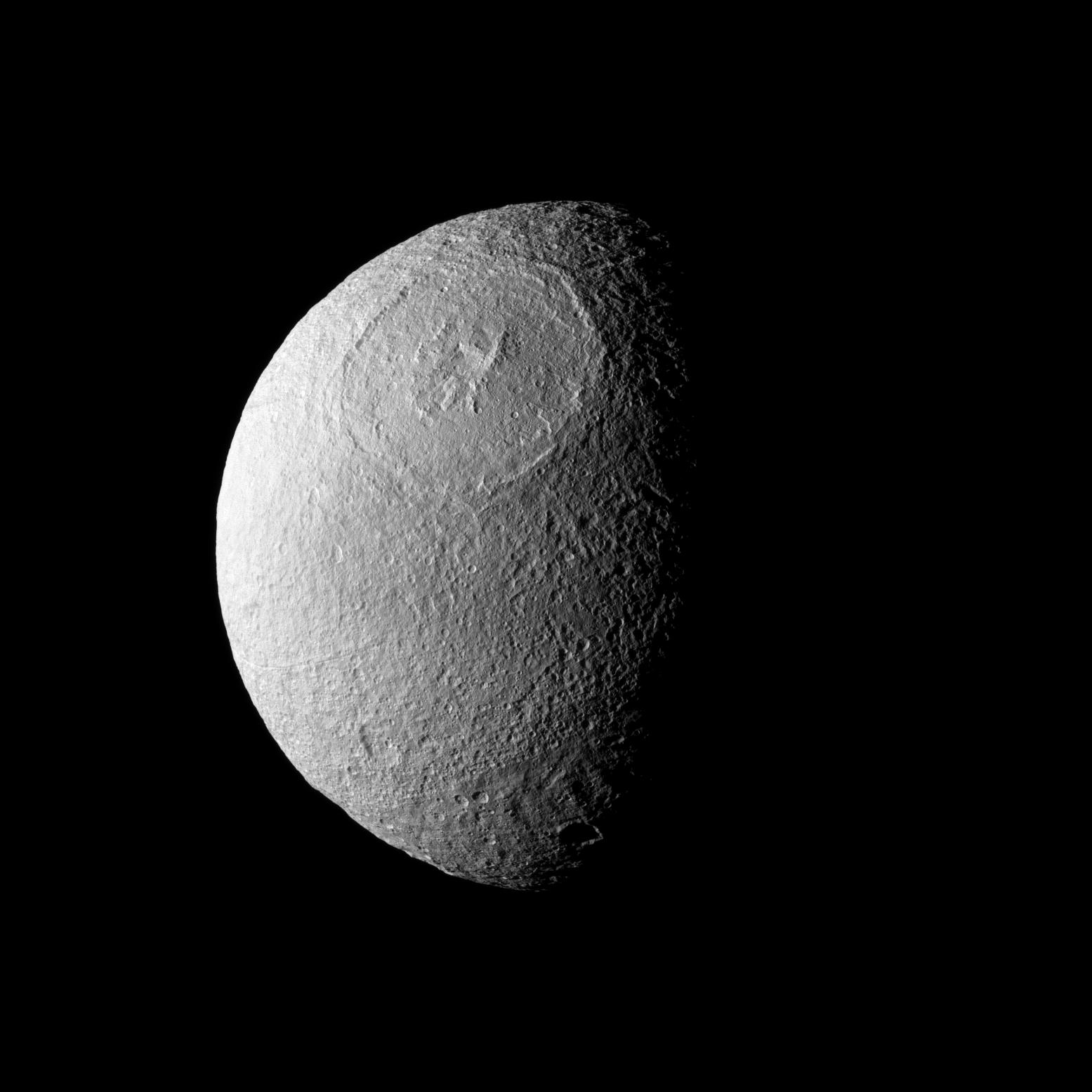 Odysseus Crater, with a size of epic proportions, stretches across a large northern expanse on Saturn's moon Tethys. Credit: NASA/JPL/Space Science Institute