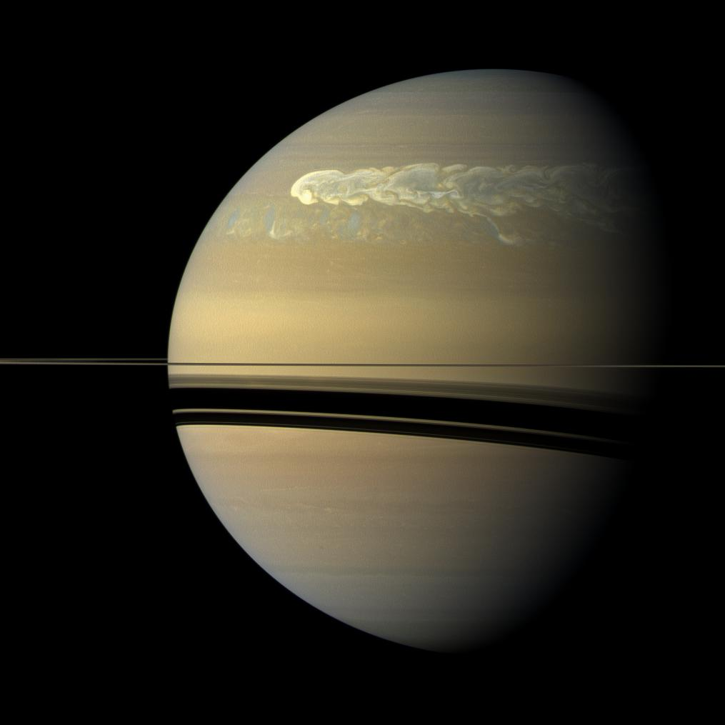 The huge storm churning through the atmosphere in Saturn's northern hemisphere overtakes itself as it encircles the planet. Credit: NASA/JPL-Caltech/SSI