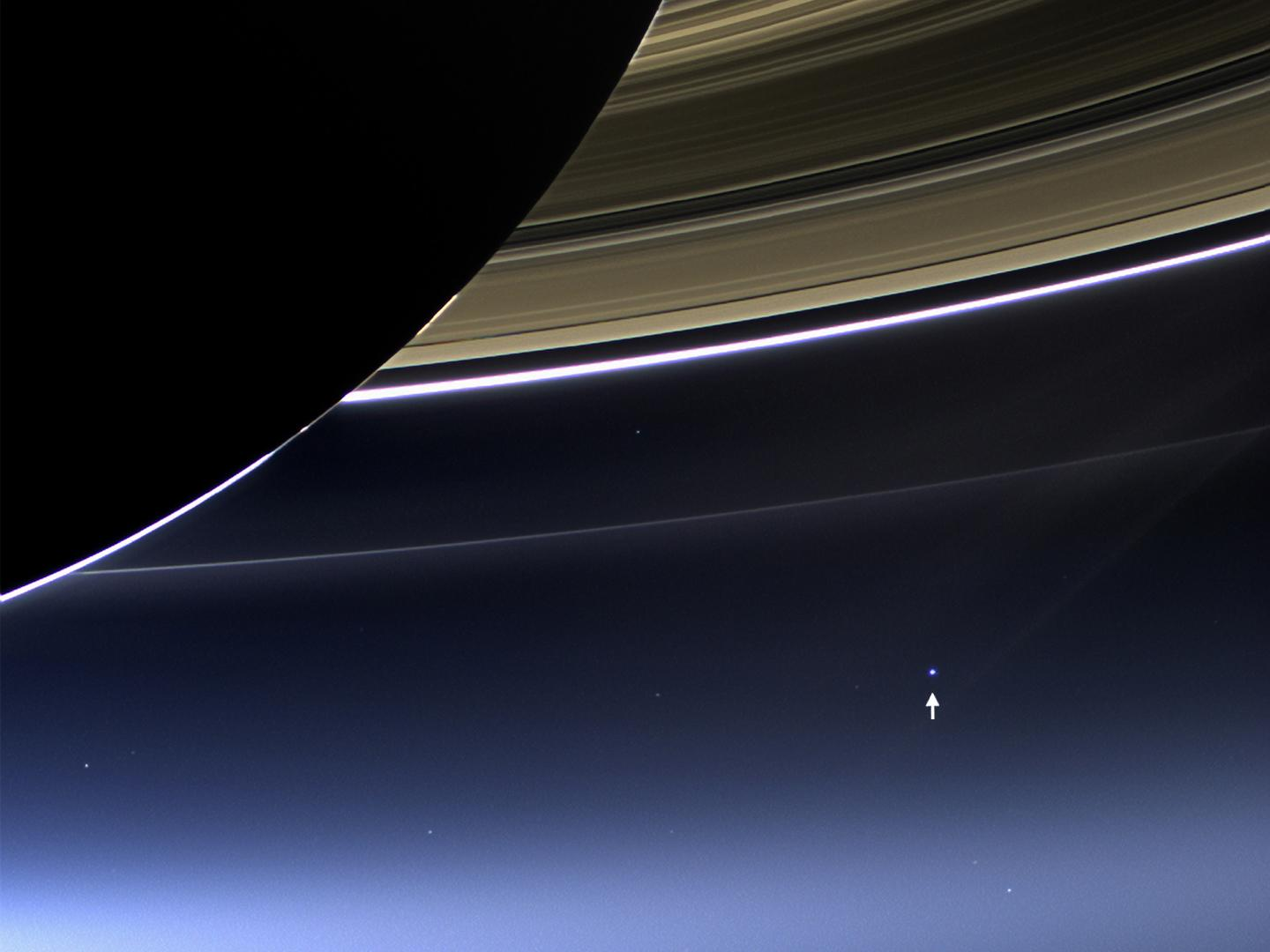 This rare image has captured Saturn's rings and our planet Earth and its moon in the same frame. Earth, which is 898 million miles away in this image, appears as a blue dot at center right; the moon can be seen as a fainter protrusion off its right side. Credit: NASA/JPL-Caltech/Space Science Institute