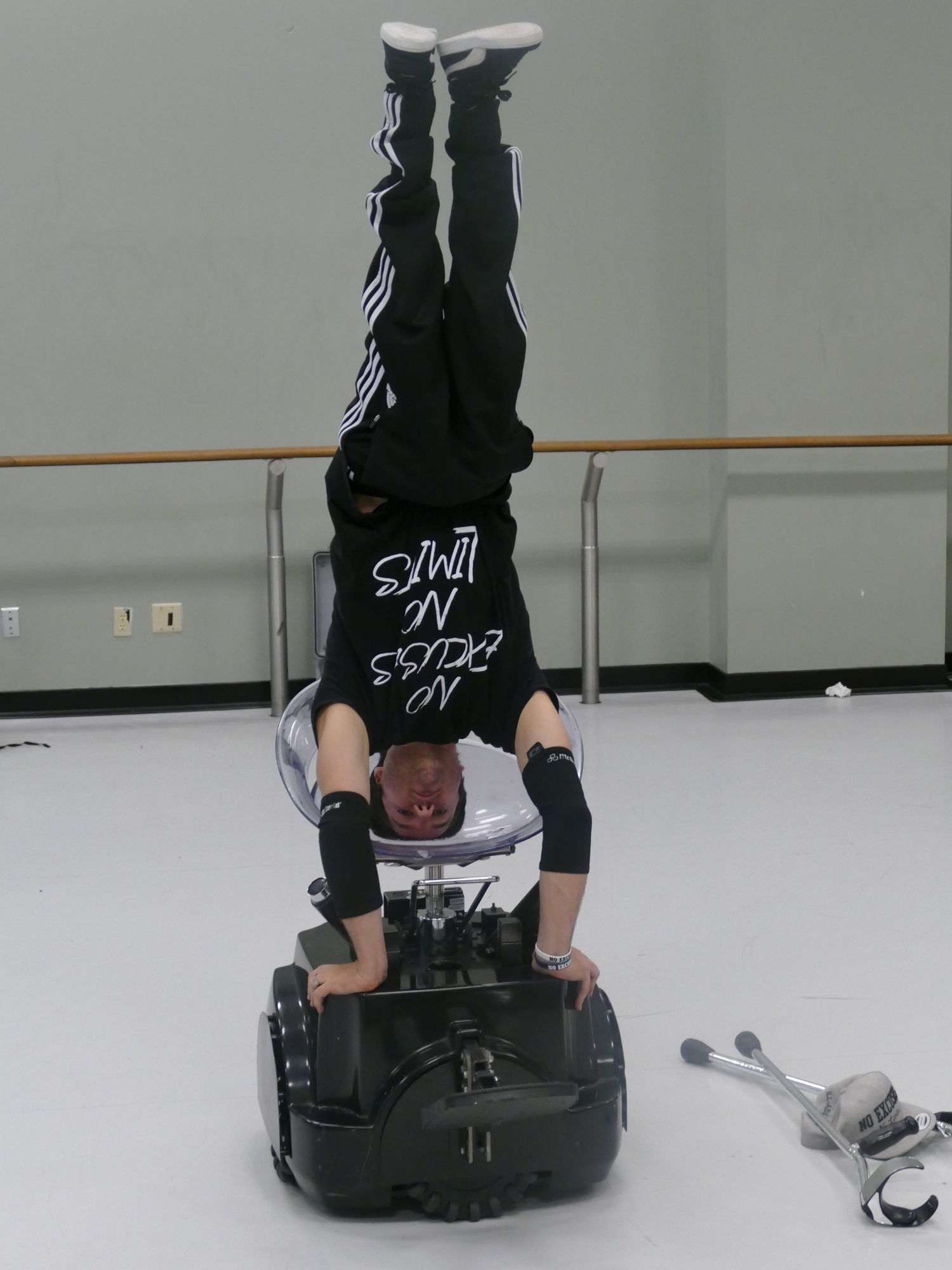 "B-boy Luca ""Lazylegz"" Patuelli tests a handstand on the Rolling Dance Chair."