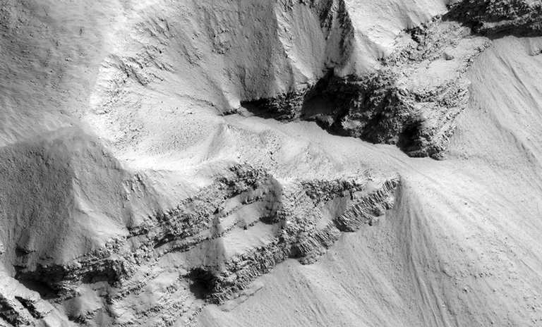 Close-up of a sections of the Marte Vallis crater. Credit: NASA/JPL/University of Arizona