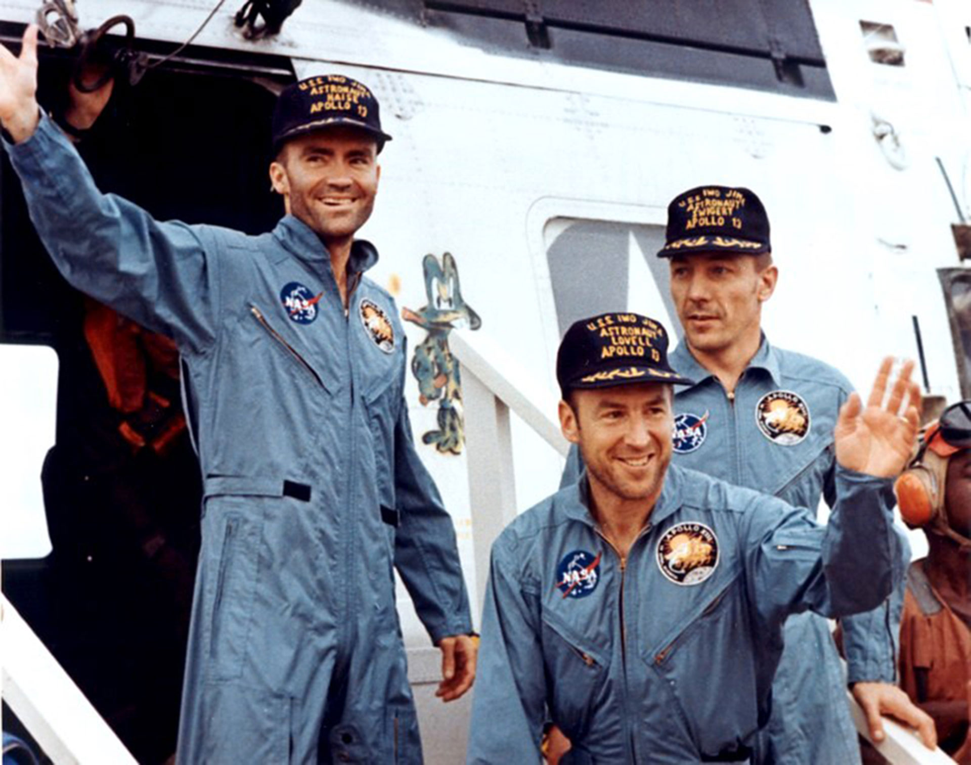 "The crewmembers of Apollo 13—Fred Haise (left), Jim Lovell, and Jack Swigert—step aboard the ""USS Iwo Jima"" following splashdown and recovery operations in the south Pacific Ocean on April 17, 1970. Credit: NASA"