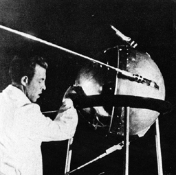 black and white image of sputnik and technician