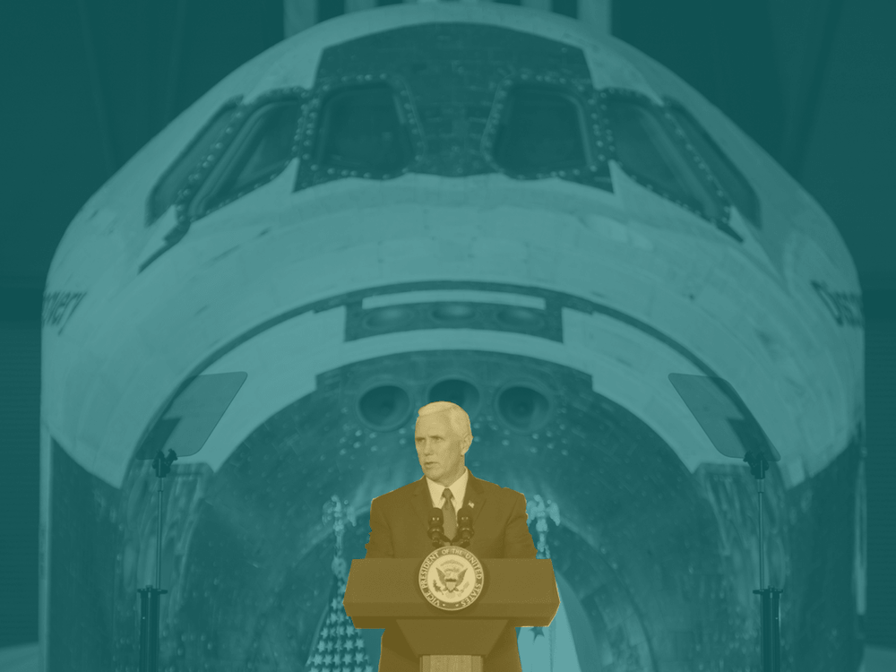 Vice President Pence standing in front of space shuttle