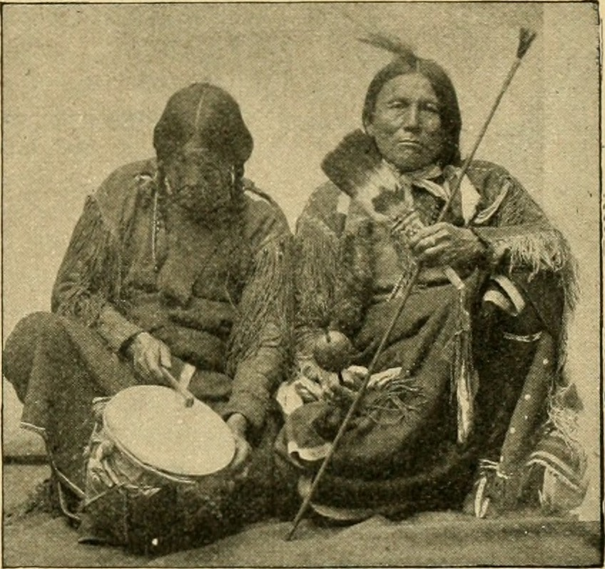 two native americans with instruments