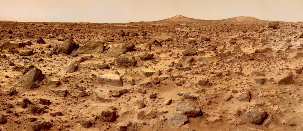 ground level shot of rough, red surface of Mars