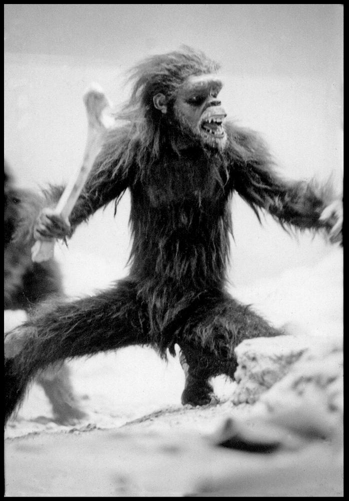 Dan Richter in ape costume wielding bone
