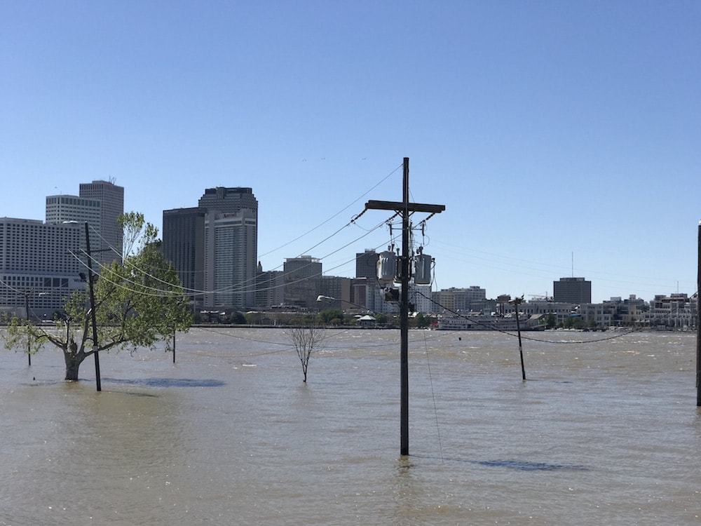 high water levels in new orleans, water is covering streets and surrounding electric poles