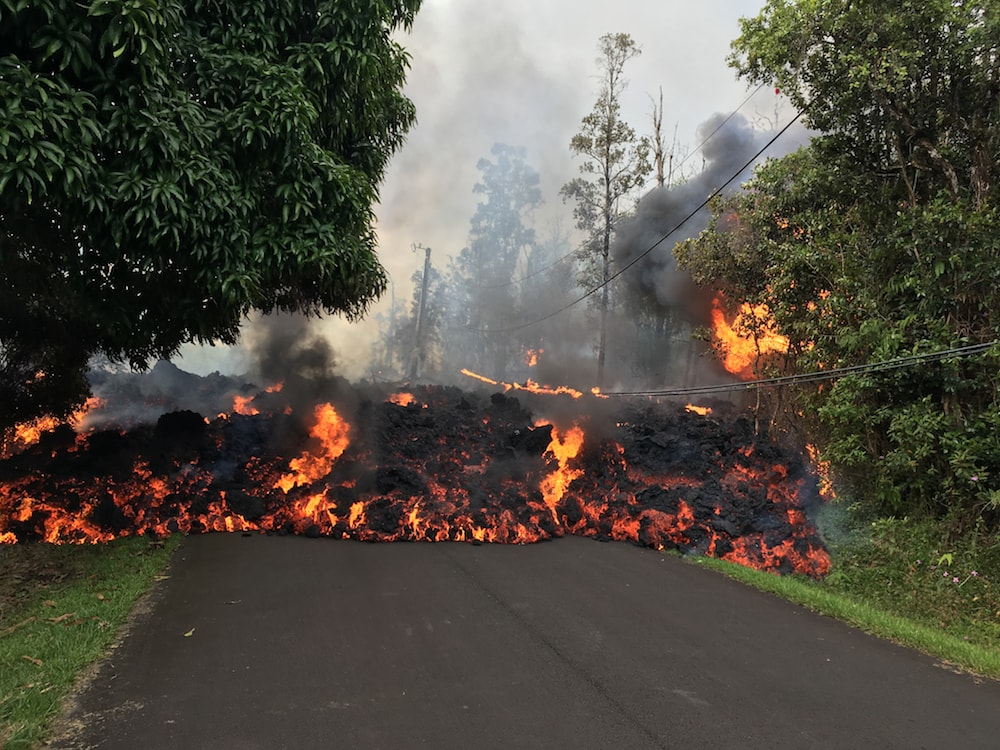 a short wall of lava consumes a street