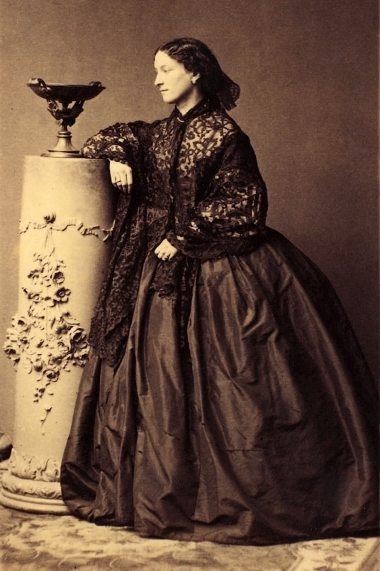 a vintage sepia tinted photograph of a woman (jeanne villepreux-power) in a dress