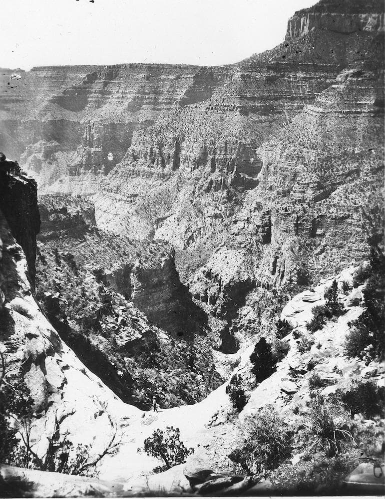 a black and white photograph of the grand canyon back when it was first explored in the 1800s