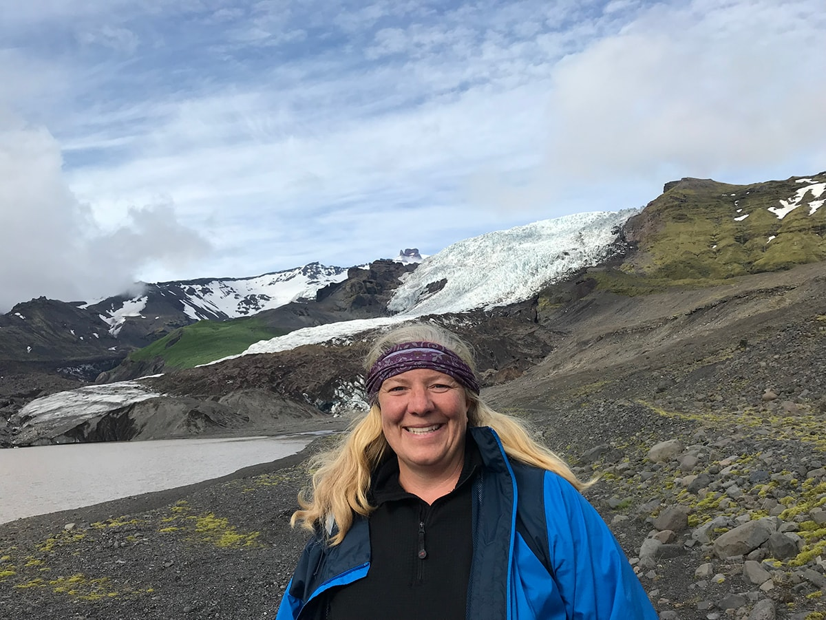 Katie Brown standing in front of a glacial mountainside.