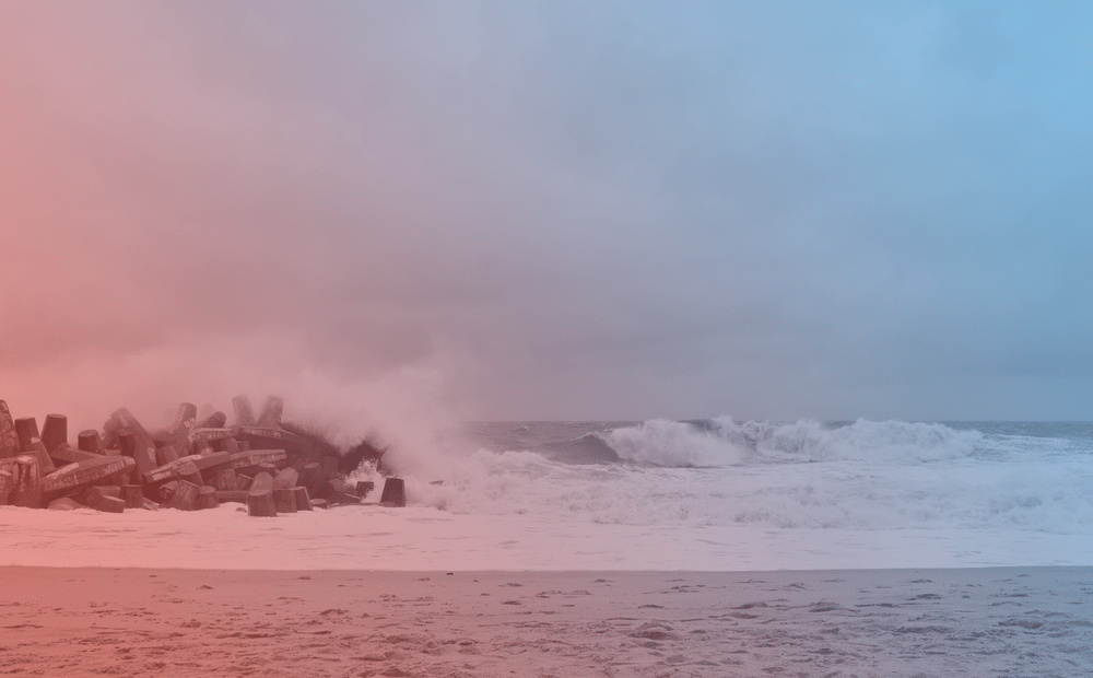 a blue and red tinted photo of a beach with waves crashing to show under a gray sky