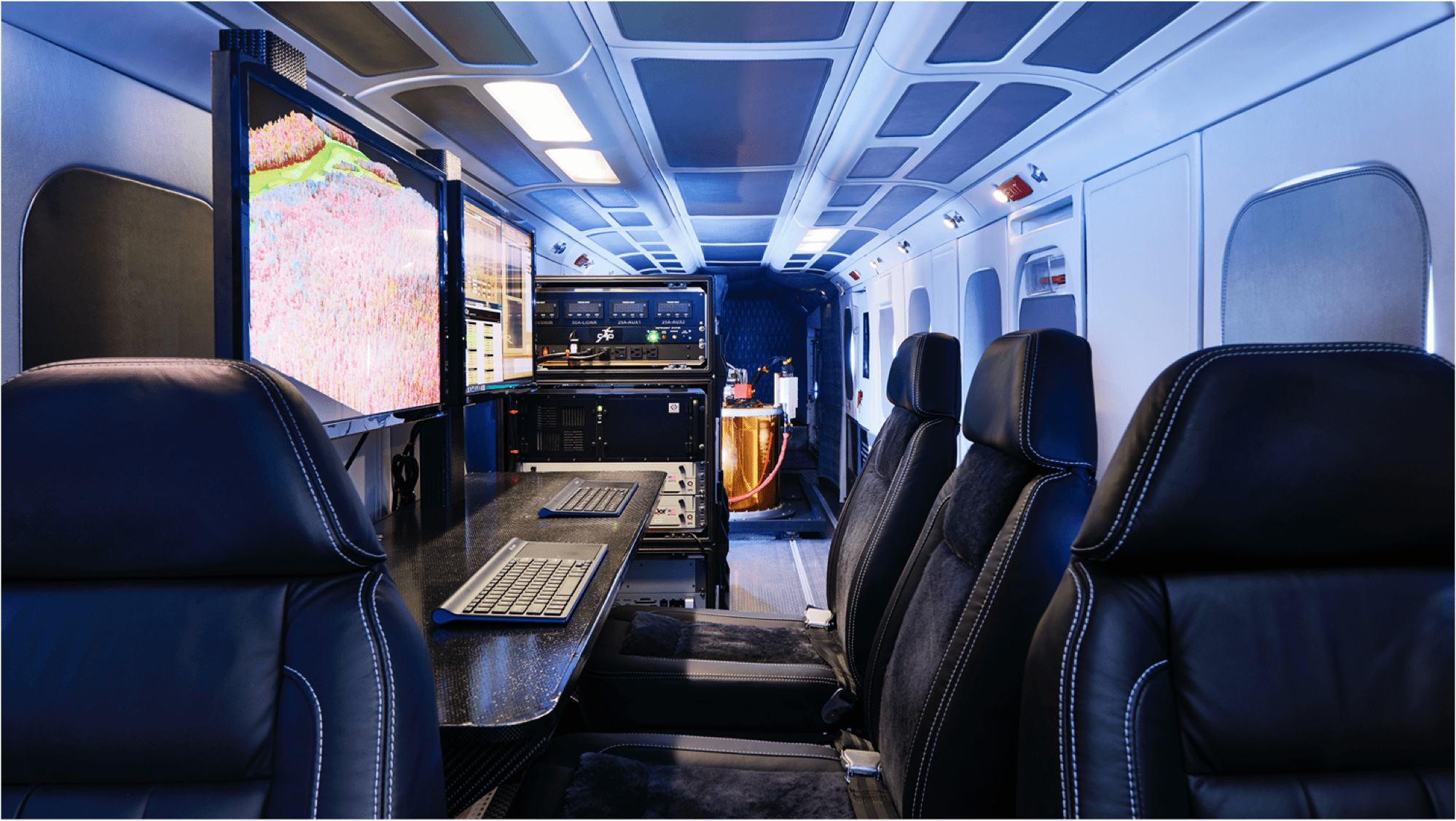 inside of plane with big computer screen and equipment