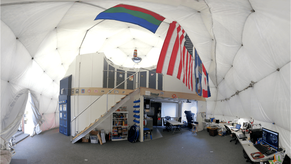 inside the dome of Hawaii station, with white walls and computers