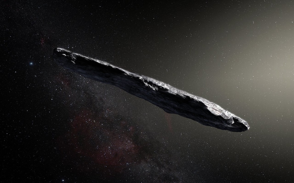 a cigar-like asteroid going through deep space