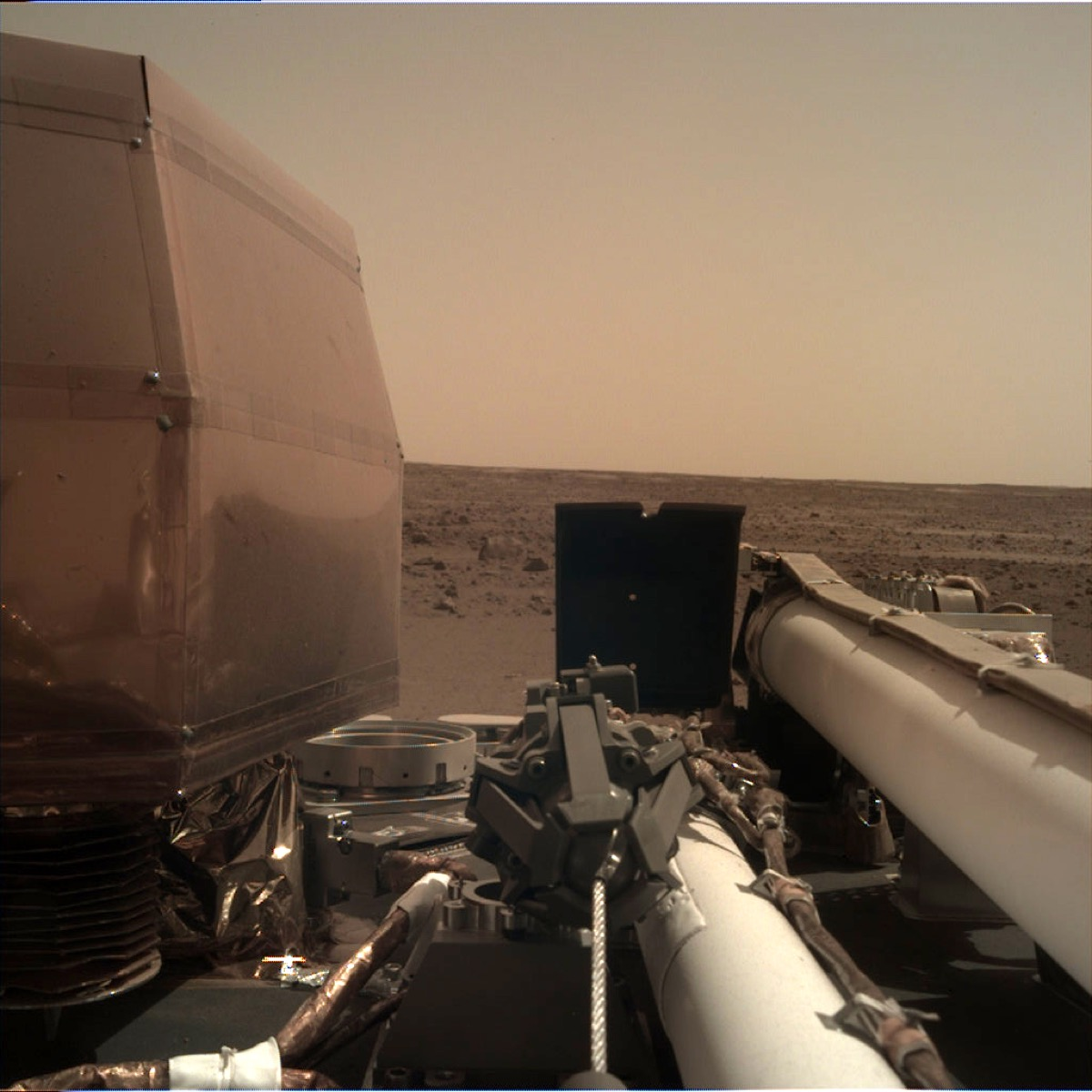 Lander arm underneath red martian sky