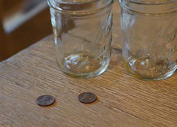 two dull pennies and two glass jars