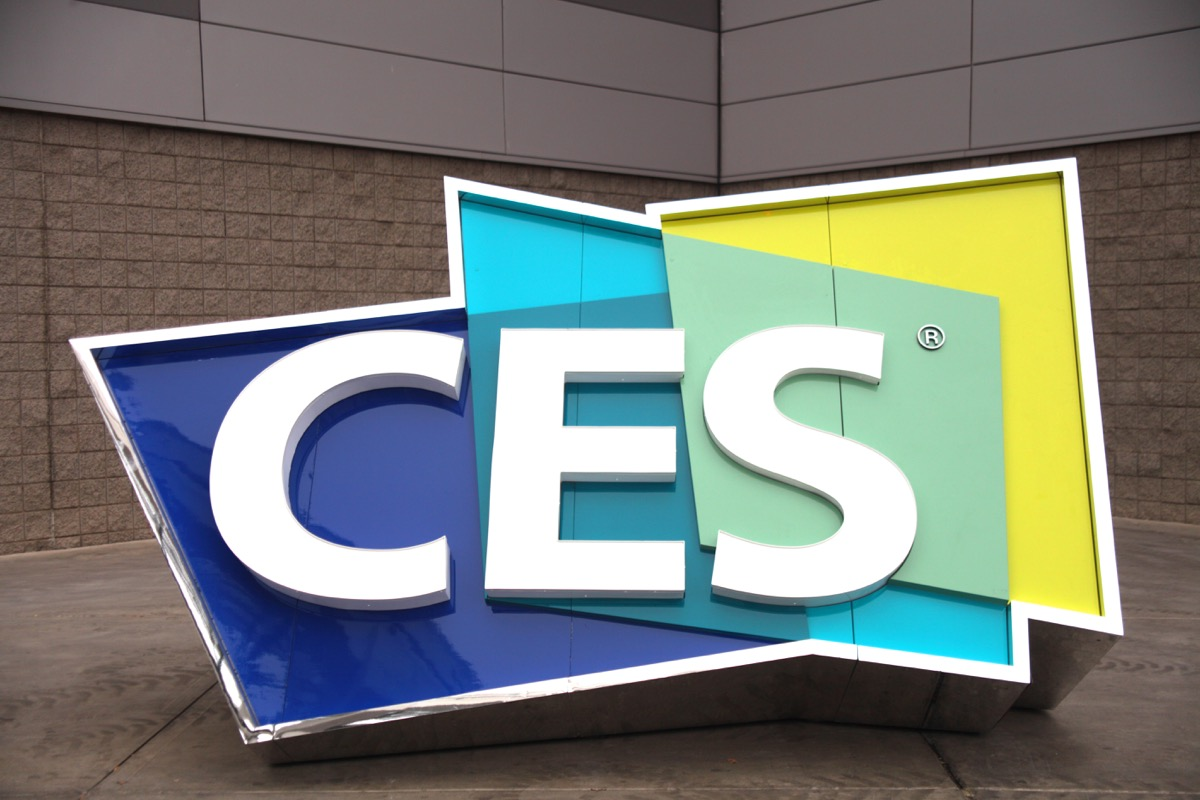 the logo for CES, large letters on top of three polygons, outside of a convention center