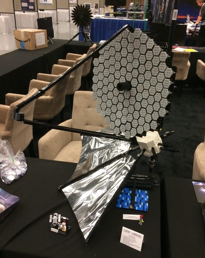 a lego model of the luvoir mirror on a conference table