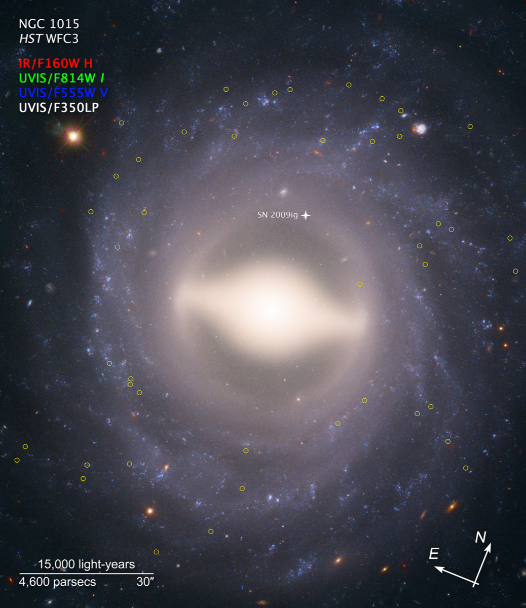 a circular, swirling galaxy with a bright center. there are yellow circles around particular stars in the photo