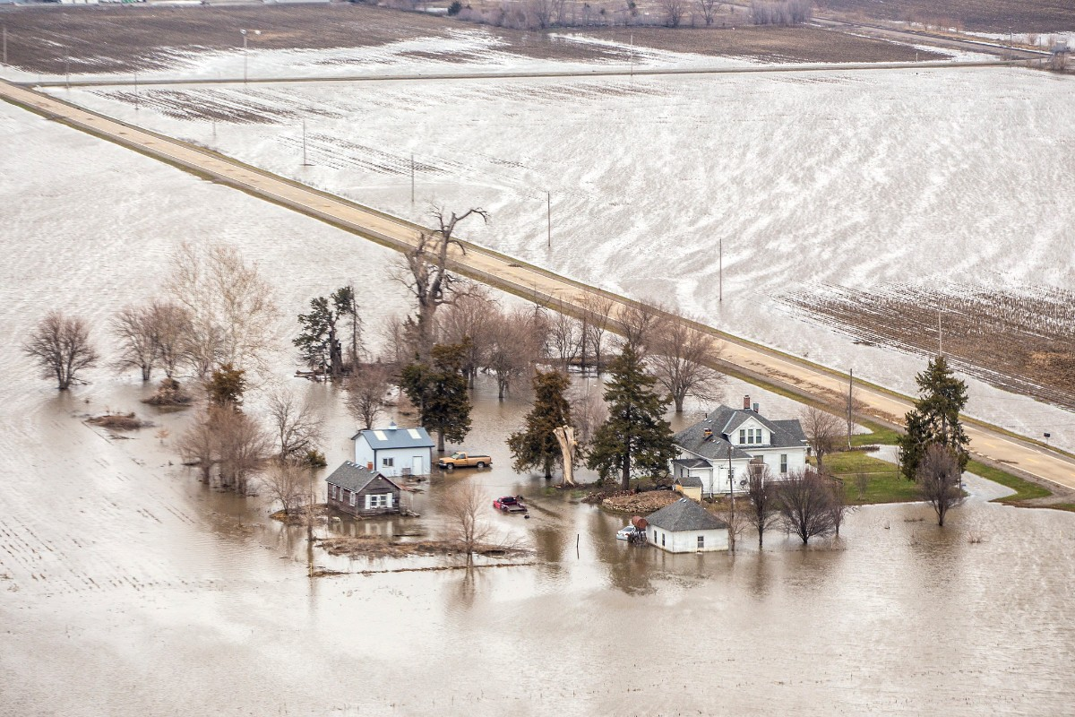 a large farm field flooded in brown water