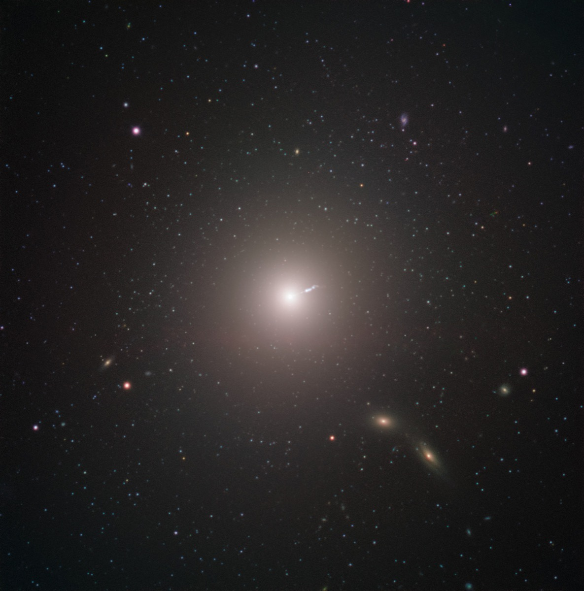 a bright pinpoint in the middle of a starfield. the bright pinpoint is the messier galaxy